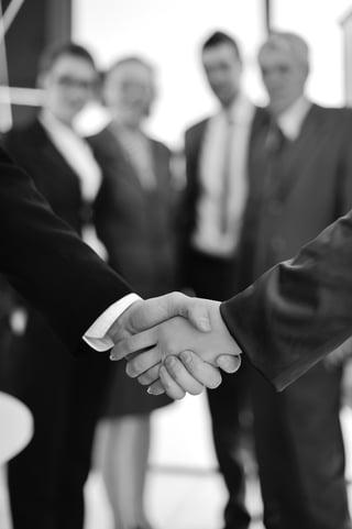 Handshake on business background.jpeg